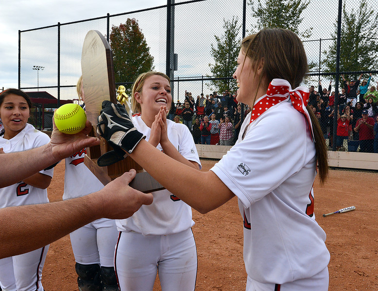 Cassidy Smith, right, and Bradey King receive the state 5A softball championship trophy after defeating Dakota Ridge on Saturday at Aurora Sports Park.<br /> <br /> <br /> October 20, 2012<br /> staff photo/ David R. Jennings