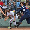 Loveland's Colissa Bakovich is tagged out after begin chased down by Dakota Ridge's Breanna Hixon near home plate during Saturday's state 5A softball championship game at Aurora Sports Park.<br /> <br /> October 20, 2012<br /> staff photo/ David R. Jennings