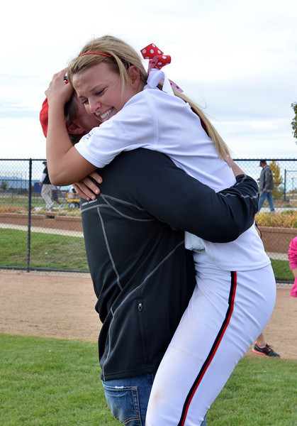 Bradey King is hugged by her father Mark King after Loveland won the state 5A softball championship game against Dakota Ridge on Saturday at Aurora Sports Park.<br /> <br /> October 20, 2012<br /> staff photo/ David R. Jennings
