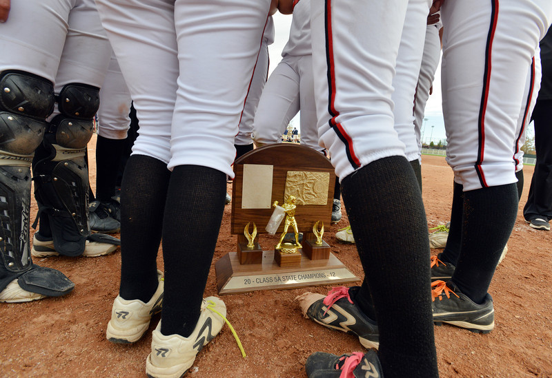 The Loveland Indians stand around the state 5A softball championship trophy after Saturday's game against Dakota Ridge at Aurora Sports Park.<br /> <br /> October 20, 2012<br /> staff photo/ David R. Jennings