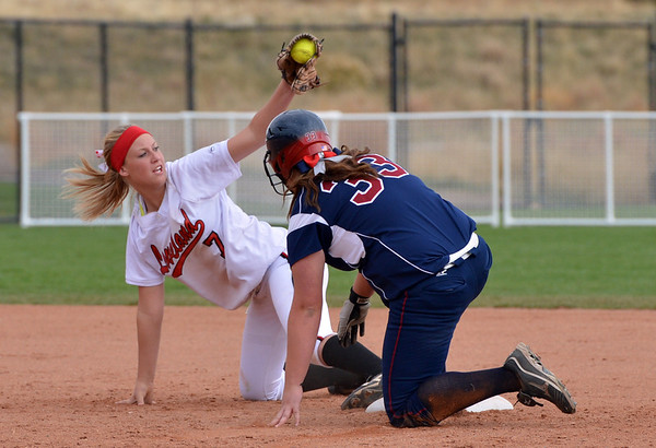 Loveland's Annika Anderson signals to the umpire she tagged out Dakota Ridge's Cassidy Creekmore at second base during Saturday's state 5A softball championship game at Aurora Sports Park.<br /> <br /> October 20, 2012<br /> staff photo/ David R. Jennings