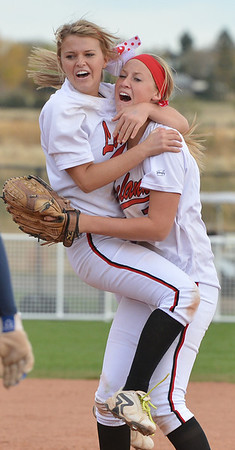 Loveland's Bradey King, left, celebrates with Annikca Anderson after defeating Dakota Ridge in the state 5A softball championship at Aurora Sports Park.<br /> <br /> October 20, 2012<br /> staff photo/ David R. Jennings