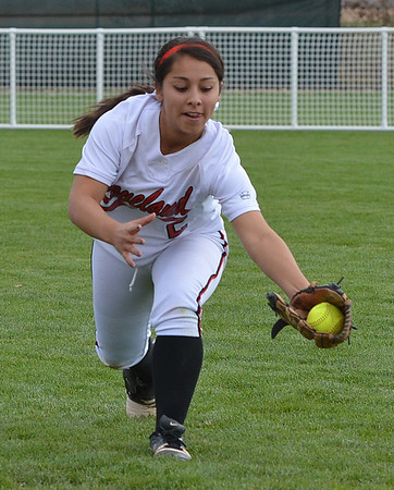 Loveland's Maria Preciado catches a ball in the outfield hit by Dakota Ridge during Saturday's state 5A softball championship game at Aurora Sports Park.<br /> <br /> October 20, 2012<br /> staff photo/ David R. Jennings