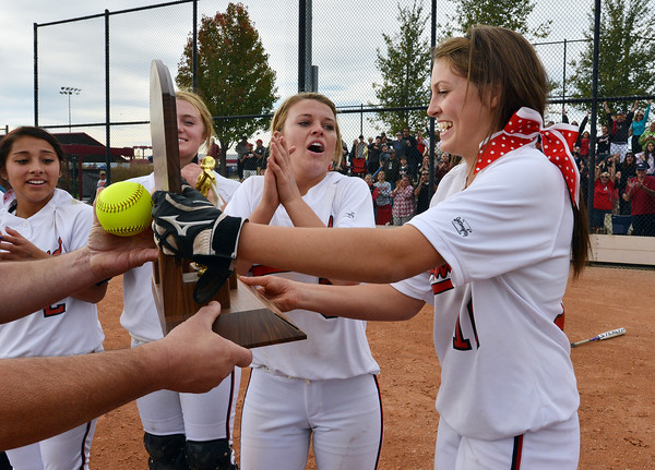 Cassidy Smith, right, and Bradey King receive the state 5A softball championship trophy after defeating Dakota Ridge on Saturday at Aurora Sports Park.<br /> <br /> October 20, 2012<br /> staff photo/ David R. Jennings
