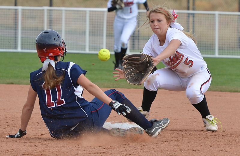 Loveland's Bradey King tags out Dakota Ridge's Kayla Fridgen at second base during Saturday's state 5A softball championship game at Aurora Sports Park.<br /> <br /> October 20, 2012<br /> staff photo/ David R. Jennings