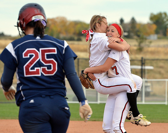 Loveland's Bradey King, left, celebrates with Annikca Anderson after defeating Dakota Ridge in the state 5A softball championship at Aurora Sports Park.<br /> <br /> October 19, 2012<br /> staff photo/ David R. Jennings