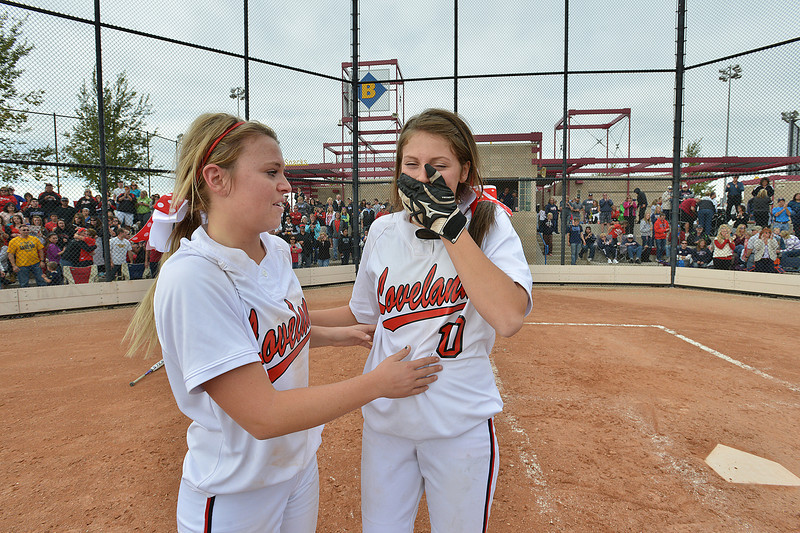 Cassidy Smith, left, and Bradey King celebrate after defeating Dakota Ridge in Saturday's state 5A softball championship game at Aurora Sports Park.<br /> <br /> October 20, 2012<br /> staff photo/ David R. Jennings