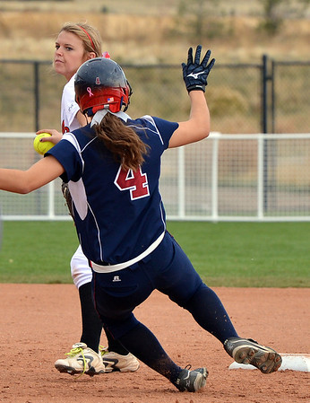 Loveland's Bradey King forces out Dakota Ridge's Morgan Wilhelm at second base during Saturday's state 5A softball championship game at Aurora Sports Park.<br /> <br /> October 20, 2012<br /> staff photo/ David R. Jennings