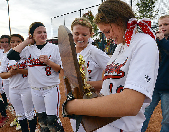 Cassidy Smith, right, reads the inscription on the state 5A softball championship trophy after defeating Dakota Ridge on Saturday at Aurora Sports Park.<br /> <br /> October 20, 2012<br /> staff photo/ David R. Jennings