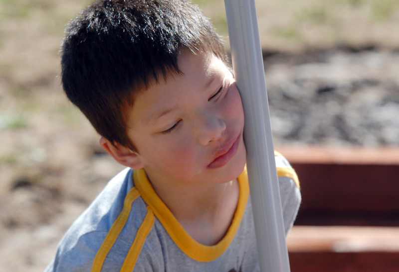 Gabriel Staley, 5, leans on a shovel after helping dig a hole for the water lines in the garden being installed by Lowe's employees at Birch Elementary School on Wednesday.<br /> <br /> August 11, 2010<br /> Staff photo/ David R Jennings