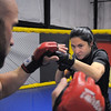 MMA fighter Cat Zingano during practice demonstrates mixed martial arts moves with instructor Dan Bentenz at Zingano Jiu Jitsu in Broomfield on Wednesday.<br /> February 17, 2011<br /> staff photo/David R. Jennings