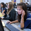Stephanie Ho, right, works on her essay on being mature using MY Access! program by Vantage Learning during  Judy Kurtz's 10th grade world studies class on Tuesday. Fellow classmates  Stephanie To, left, and Tristin Chadd also work on their essays during class. Vantage Learning gave a $300,200.00 grant to Adams 12 schools for the program.<br /> Sept. 22, 2009<br /> Staff photo/David R. Jennings