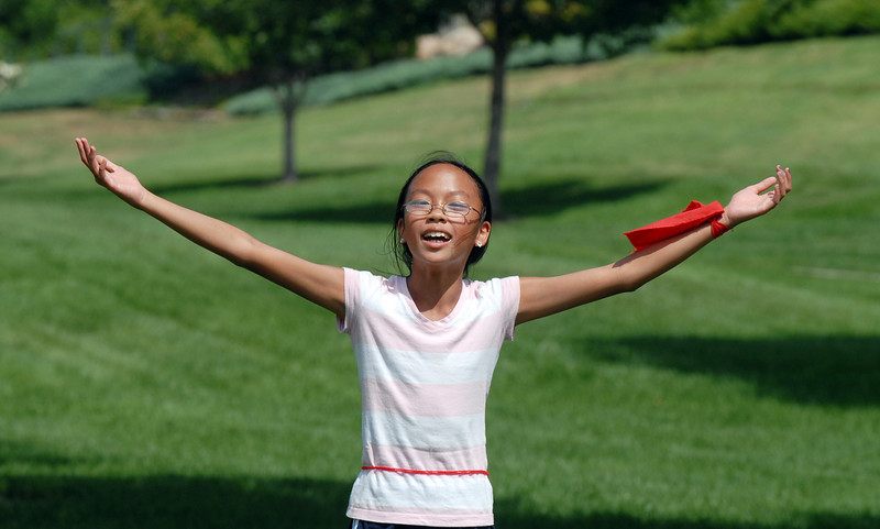 Monica Mah, 11, asks for help to get unfrozen by her Gryffindor teammates during Wednesday's 2010 Quidditch Cup in celebration of Harry Potter at Community Park.<br /> July 21, 2010<br /> Staff photo/ David R. Jennings