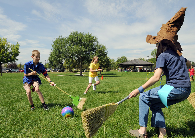 Zac Johnson, 13, left, and Austin Baltzer, 11, Ravenclaw team go after the quaffle ball on the pitch of Community Park during Wednesday's 2010 Quidditch Cup tournament in celebration of Harry Potter.<br /> July 21, 2010<br /> Staff photo/ David R. Jennings
