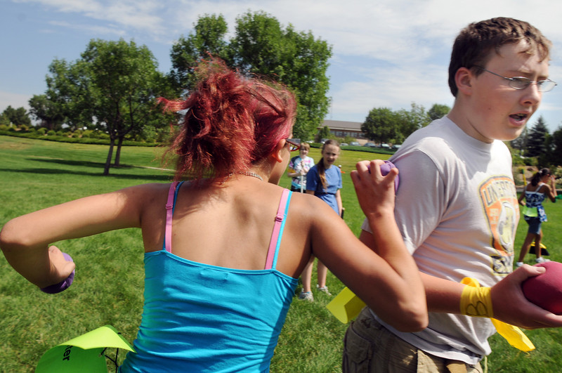 Slytherin's Idalys Spear, 17, left, uses a bludger ball to freeze Hufflepuff's Nate Fulton, 16, right, during Wednesday's 2010 Quidditch Cup in celebration of Harry Potter at Community Park.<br /> July 21, 2010<br /> Staff photo/ David R. Jennings