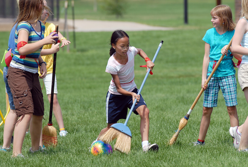 Monica Mah, 11, center, sweeps the quaffle ball down the pitch for Gryffindor during Wednesday's 2010 Quidditch Cup in celebration of Harry Potter at Community Park.<br /> July 21, 2010<br /> Staff photo/ David R. Jennings