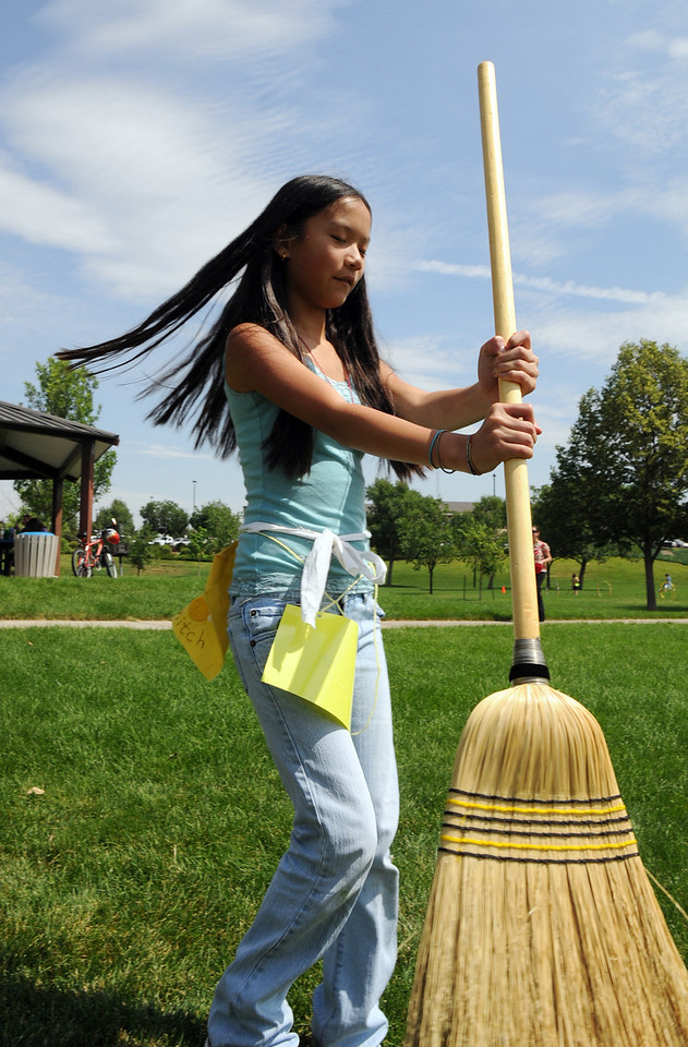 Kaili Mouscher, 13, spins holding a broom for a game during Wednesday's 2010 Quidditch Cup in celebration of Harry Potter at Community Park.<br /> July 21, 2010<br /> Staff photo/ David R. Jennings