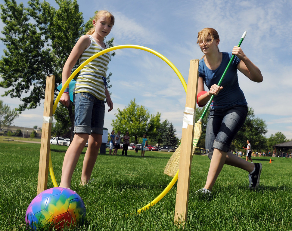 Megan Martin, 11, Ravenclaw, stands frozen watching Rebekah George, 15, left, sweep the quaffle ball through one of three hoops to score 10 points for Gryffindor during Wednesday's 2010 Quidditch Cup in celebration of Harry Potter at Community Park.<br /> July 21, 2010<br /> Staff photo/ David R. Jennings