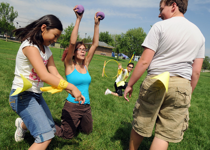 Idalys Spear, 17, center, signals to her Slytherin teamates to unfreeze her while Schandra Xu, 10, left, unfreezes Hufflepuff teammate Nate Fulton, 16, during Wednesday's 2010 Quidditch Cup in celebration of Harry Potter at Community Park.<br /> July 21, 2010<br /> Staff photo/ David R. Jennings