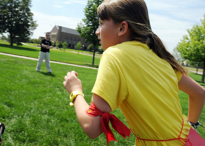 Katie Sanko, 11, seeker for Gryffindor runs to try to catch the snitch during Wednesday's 2010 Quidditch Cup in celebration of Harry Potter at Community Park.<br /> July 21, 2010<br /> Staff photo/ David R. Jennings