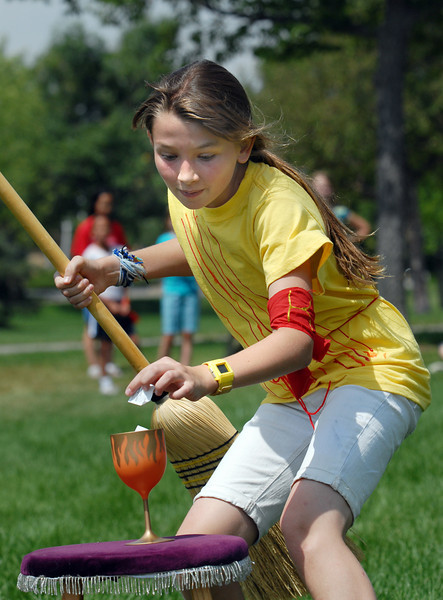 Katie Sanko, 11, places her name in the cup for a game during Wednesday's 2010 Quidditch Cup in celebration of Harry Potter at Community Park.<br /> July 21, 2010<br /> Staff photo/ David R. Jennings