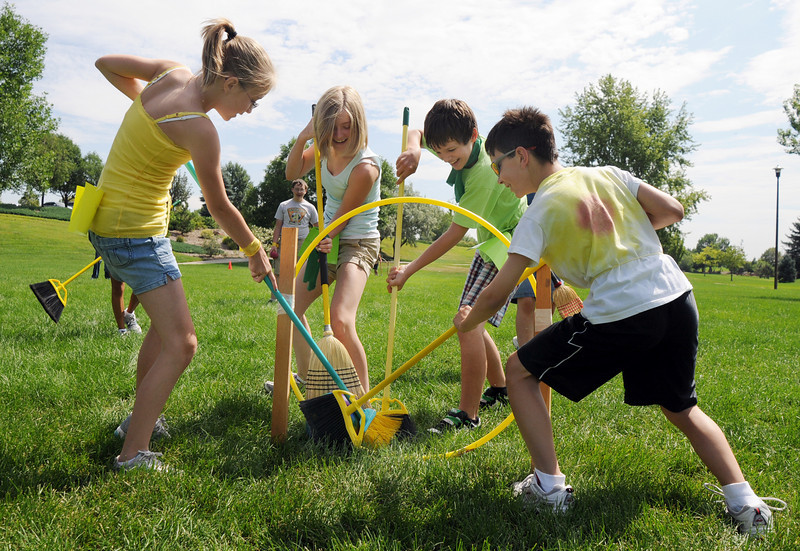 Hufflepuff's Meghan Brozovich, 11, left, and Antonio Cabrera, 11, right, try to keep Slytherin's Lexi Brozovich, 12, and Parker Loertscher, 11, from scoring during Wednesday's 2010 Quidditch Cup in celebration of Harry Potter at Community Park.<br /> July 21, 2010<br /> Staff photo/ David R. Jennings