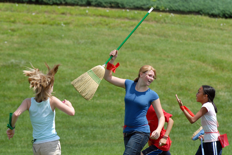 Rebekah George, 15, signals a score for her team, Gryffindor, during Wednesday's 2010 Quidditch Cup in celebration of Harry Potter at Community Park.<br /> July 21, 2010<br /> Staff photo/ David R. Jennings