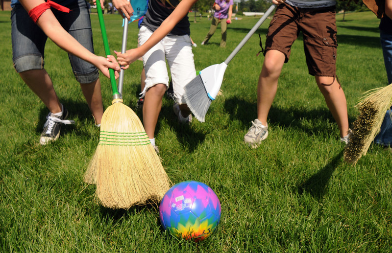 Brooms fly as teams try to control the quaffle ball during Wednesday's 2010 Quidditch Cup in celebration of Harry Potter at Community Park.<br /> July 21, 2010<br /> Staff photo/ David R. Jennings