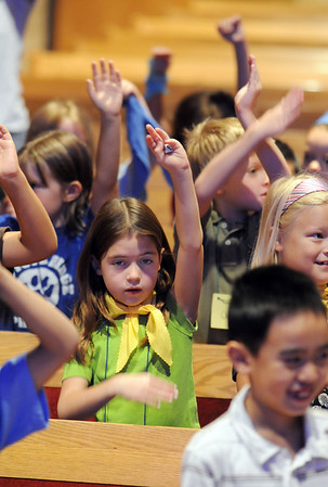 Anjolie Konrath, 7, sings and gestures to a song about time during Math Camp held at the United Methodist Church on Friday.<br /> <br /> August 7, 2009<br /> staff photo/David R. Jennings