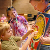 Charlie Cappelletti, 7, left, moves the dial on a clock while Erin Crawford, 13, watches and is held by Shelly Crawford during Math Camp held at the United Methodist Church on Friday.<br /> <br /> August 7, 2009<br /> staff photo/David R. Jennings