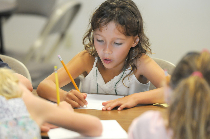 Madelene Kleinhaus, 7, works on writing estimates down during Math Camp held at the United Methodist Church on Friday.<br /> <br /> August 7, 2009<br /> staff photo/David R. Jennings