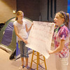 Olivia Hopley, 12, left, and Erin Crawford, 13, hold a sign displaying the words to song for the students to sing at Math Camp held at the United Methodist Church on Friday.<br /> <br /> August 7, 2009<br /> staff photo/David R. Jennings