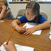 Grace Lewis, 7, works  on math problems during Math Camp held at the United Methodist Church on Friday.<br /> <br /> August 7, 2009<br /> staff photo/David R. Jennings