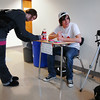 Lizzy Feicht, left, writes a message on a sticky note for Broomfield High senior Max Lee's Day of Silence photography exhibit  for the  gay and straight alliance at the school on Friday. <br /> <br /> April 16, 2010<br /> Staff photo/David R. Jennings