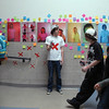 Broomfield High senior Max Lee holds markers for students sign their names and write comments about his Day of Silence photography exhibit for the  gay and straight alliance at the school on Friday. <br /> <br /> April 16, 2010<br /> Staff photo/David R. Jennings