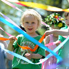MAYPOLE06<br /> Damian Dematteo, 4, participates in a Maypole dance with his classmates at the May Faire held at the Boulder Waldorf Kindergarten on Friday morning.<br /> Photo by Marty Caivano/Camera/May 21, 2010