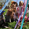 MAYPOLE04<br /> Teacher Rachel Solt, center, guides her students in the start of a Maypole dance at the May Faire held at the Boulder Waldorf Kindergarten on Friday morning.<br /> Photo by Marty Caivano/Camera/May 21, 2010