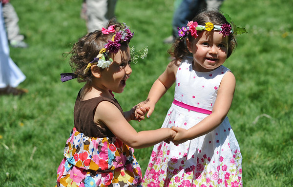 MAYPOLE03<br /> Zahara Bacal, 3, left, and her friend Robin Ross, 2, dance at the May Faire held at the Boulder Waldorf Kindergarten on Friday morning.<br /> Photo by Marty Caivano/Camera/May 21, 2010