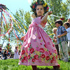 "MAYPOLE02<br /> Gabriella Jordan, 4, dances around the Maypole with her classmates at the May Faire held at the Boulder Waldorf Kindergarten on Friday morning.<br /> To see more photos and a video, go to  <a href=""http://www.dailycamera.com"">http://www.dailycamera.com</a>.<br /> Photo by Marty Caivano/Camera/May 21, 2010"