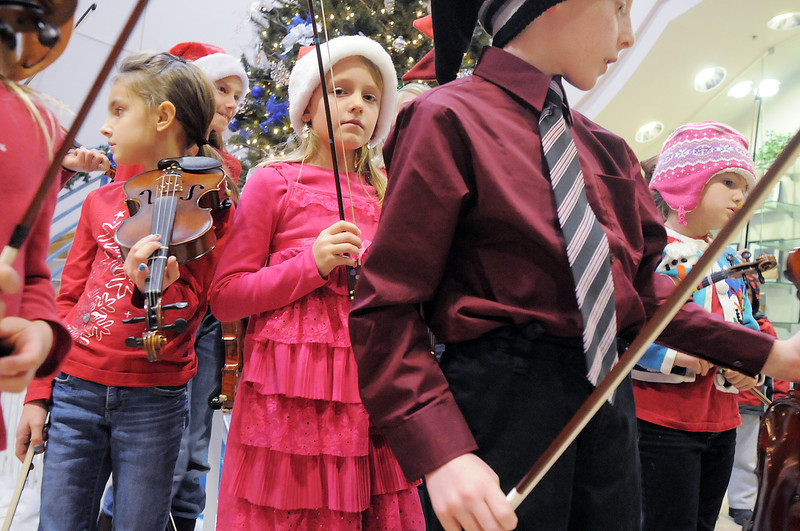 Katie Ziegler, 8, center, waits to play with the Suzuki Violin Students during the tree lighting ceremony at the George Di Ciero City and County Building on Friday.<br /> <br /> December 2, 2011<br /> staff photo/ David R. Jennings