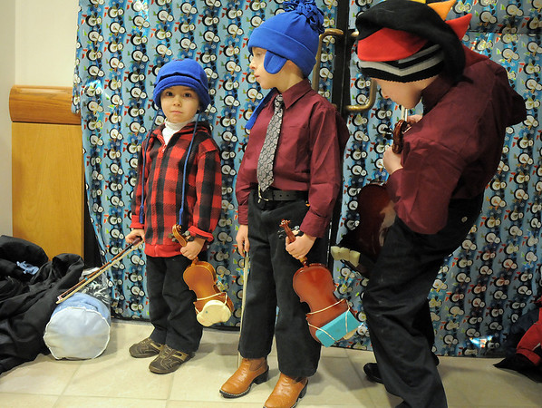 Suzuki Violin Students Simon Walker, 3, left, wait with his brothers Casey, 5, and Logan, 9, to play holiday music during the tree lighting ceremony at the George Di Ciero City and County Building on Friday.<br /> <br /> December 2, 2011<br /> staff photo/ David R. Jennings