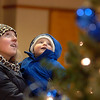 Sophie Latorre and her son Cayde, 2, look at  the holiday tree in the lobby of the George Di Ciero City and County Building before the tree lighting ceremony on Friday.<br /> <br /> December 2, 2011<br /> staff photo/ David R. Jennings