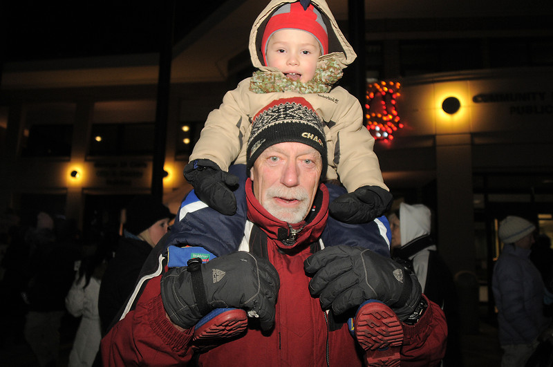 Cooper Norcross, 3, sits on his Grandpa Steve Norcross' sholders while waiting for Santa to arrive via helicopter for the tree lighting ceremony at the George Di Ciero City and County Building on Friday.<br /> <br /> December 2, 2011<br /> staff photo/ David R. Jennings