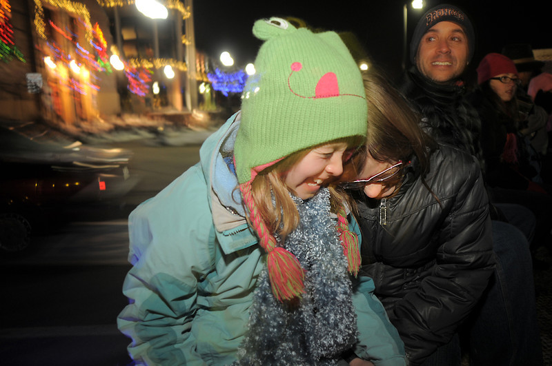 Westlake students Samantha Bryson, 12, left, and Dione Horne, 11, start to giggle while singing Christmas carols during the hayride after the tree lighting ceremony at the George Di Ciero City and County Building on Friday.<br /> <br /> December 2, 2011<br /> staff photo/ David R. Jennings