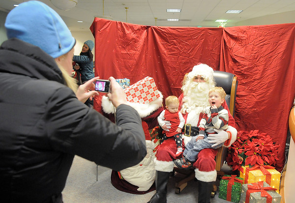 Krista Winston takes pictures of her children Delany, 7 months-old and Cooper, 3, sitting on Santa's lap after the tree lighting ceremony at the George Di Ciero City and County Building on Friday.<br /> <br /> December 2, 2011<br /> staff photo/ David R. Jennings