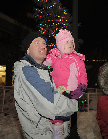 Myron Schaffer and his daughter Kira, 4, watch Santa arrive on the helicopter during the tree lighting ceremony at the George Di Ciero City and County Building on Friday.<br /> <br /> December 2, 2011<br /> staff photo/ David R. Jennings