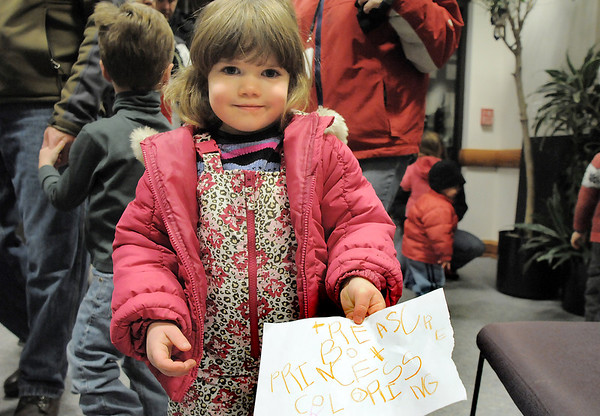 Loryn Hoffman, 4, shows her wish list while waiting in line  for Santa after the tree lighting ceremony at the George Di Ciero City and County Building on Friday.<br /> <br /> December 2, 2011<br /> staff photo/ David R. Jennings