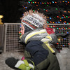 Xander Dane, 4, plays in the snow by the Mayor's Holiday Tree during the tree lighting ceremony at the George Di Ciero City and County Building on Friday.<br /> <br /> December 2, 2011<br /> staff photo/ David R. Jennings