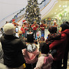 Relatives listen to the Suzuki Violin Students play holiday music during the tree lighting ceremony at the George Di Ciero City and County Building on Friday.<br /> <br /> December 2, 2011<br /> staff photo/ David R. Jennings