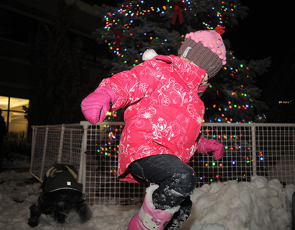 Brooke Sturtz, 4, plays in the snow in front of the Mayor's Holiday Tree during the tree lighting ceremony at the George Di Ciero City and County Building on Friday.<br /> <br /> December 2, 2011<br /> staff photo/ David R. Jennings
